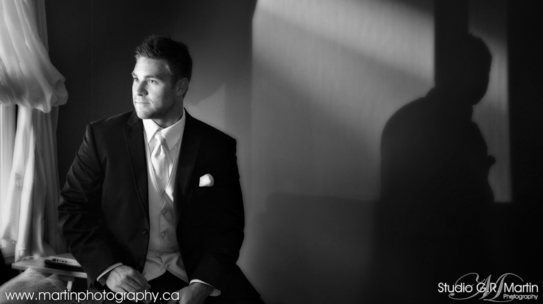 Black and white portrait of a groom getting ready - wedding photography