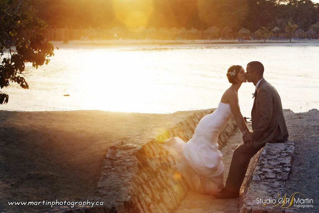 wedding sunset photo on the beach at Grand Bahia Principe hotel in Jamaica