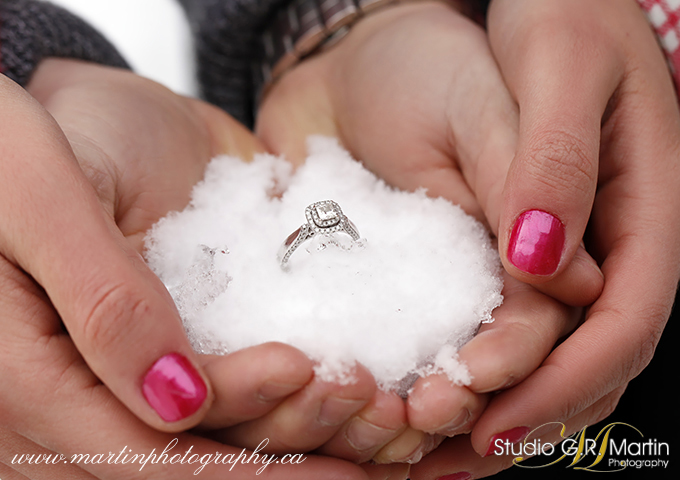 engagement ring in snow with couple's hands engagement photographers